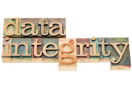 integrity: data integrity - isolated words in  letterpress wood type blocks stained by color inks