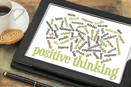 unorthodox: positive thinking word cloud on a digital tablet with a cup of coffee Stock Photo