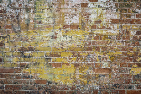 background texture of a grunge brick wall with graffiti remains Reklamní fotografie