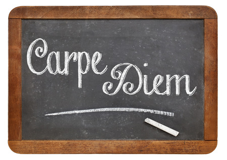 existential: Carpe Diem  handwritten with white chalk on a blackboard, isolated on white Stock Photo