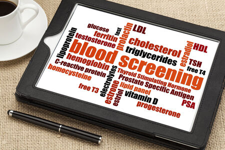 healthcare concept - blood screening word cloud on a digital tablet photo