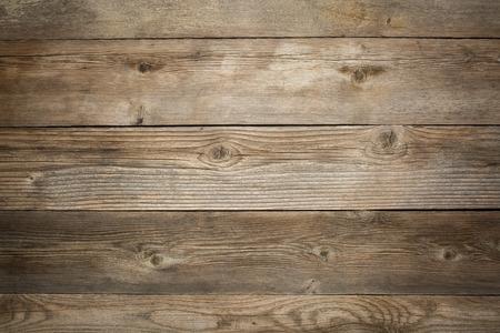 素朴な木製の背景に穀物、ノットの風化