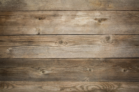 weathered: rustic weathered wood background with grain and knots