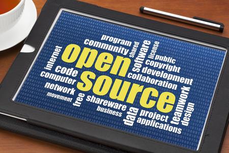 computer software: computer software development concept - open source word cloud on a digital tablet