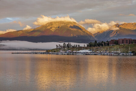 lake dillon: foggy sunrise over Lake Dillon and marina in Colorado with a mountain forest damaged by pine beetle