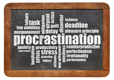 procrastination: procrastination word cloud on a vintage blackboard isolated on white Stock Photo