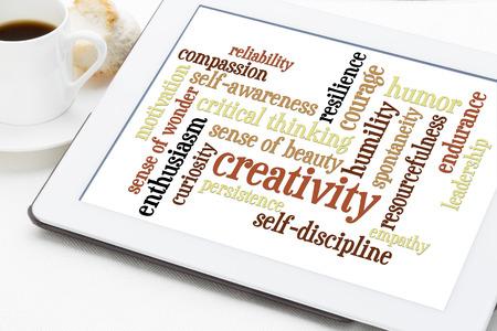 humility: la creatividad, la autodisciplina y otras cualidades personales - una nube de palabras en una tableta digital con la taza de café