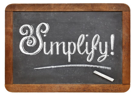 simplify: simplify suggestion or reminder  with white chalk on a vintage blackboard, isolated on white