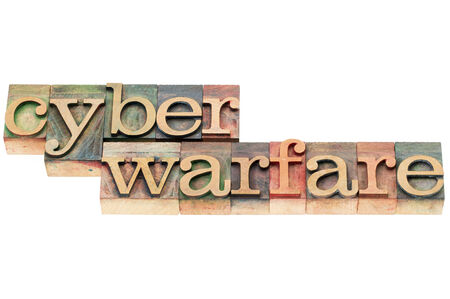cyber warfare: cyber warfare words - isolated text in letterpress wood type stained by color inks Stock Photo