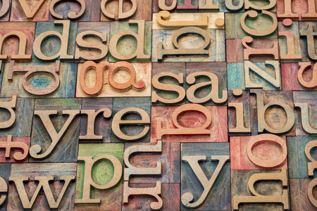 background of letterpress wood type printing blocks stained by color inks photo