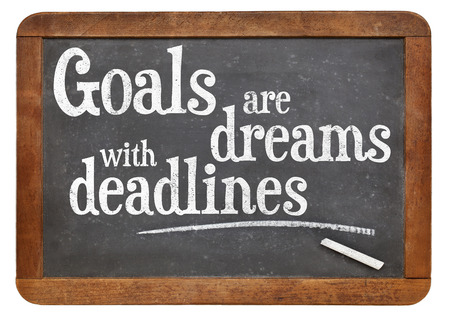 setting goals: Goals are dreams with deadlines - motivational phrase on a vintage blackboard