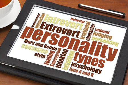 personalities: personality types word cloud on a digital tablet with a cup of tea