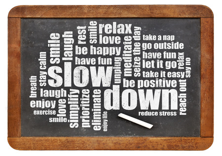 slow down and relax - reducing stress tips in a form of a word cloud on a vintage blackboard Stock Photo
