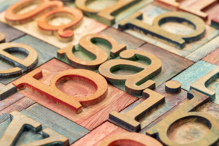 letterpress letters: alphabet abstract in  letterpress wood type printing blocks stained by color inks