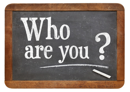 Who are you question  on a vintage blackboard isolated on white Zdjęcie Seryjne