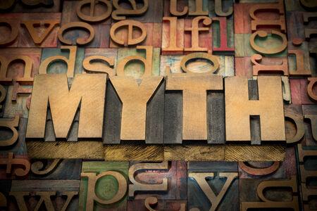 wood type: myth word in wood type against background of letterpress printing blocks