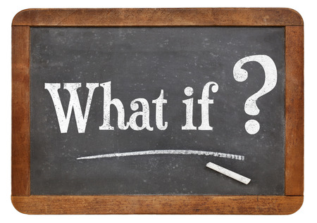 What if question  on a vintage blackboard isolated on white Stock Photo