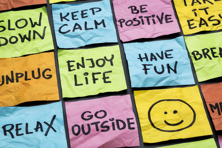 relax, keep calm, enjoy life and other motivational lifestyle reminders on colorful sticky notes Banco de Imagens - 28217986