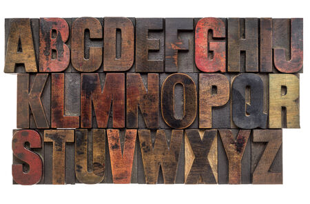 English alphabet in lettterpress wood type printing blocks, stained by color inks photo
