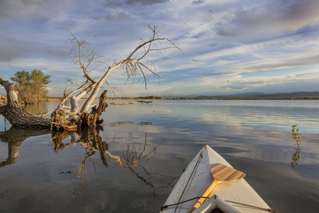 wide angle view from a canoe on a calm lake  - Lonetree Reservoir near Loveland, Colorado photo