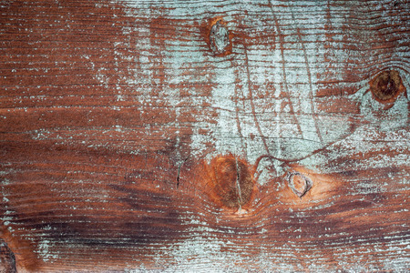 barnwood: background and texture of grunge weathered barnwood with green paint remains