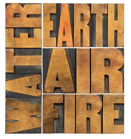 cuatro elementos: agua, tierra, aire y fuego - cuatro elementos filosóficos concepto - resumen de palabras aisladas en tipografía tipo de madera