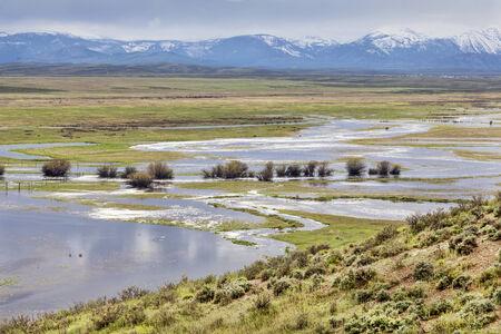 meanders: Illinois River meanders through Arapaho National Wildlife Refuge, North Park near Walden, Colorado