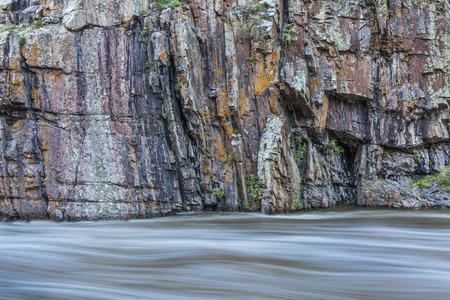 cache la poudre river: rock cliff and whitewater river - Cache la Poudre River at Little Narrows near Fort Collins, Colorado