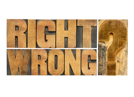 right or wrong ethical choice  dilemma - isolated vintage wood letterpress printing blocks