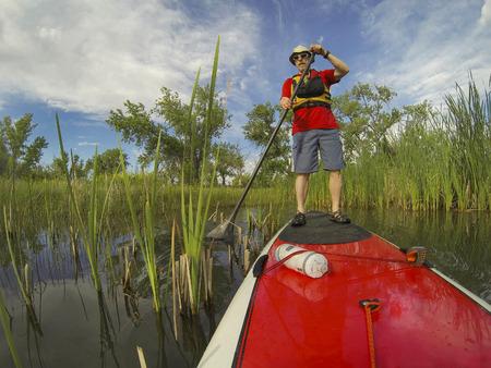 paddler: senior male paddler stand up on paddleboard Stock Photo