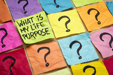 meaning: What is my life purpose question - handwriting on colorful sticky notes