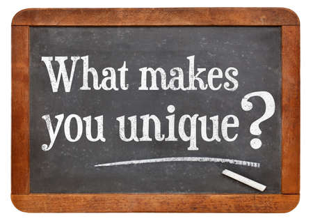 What makes you unique question  on a vintage blackboard isolated on white