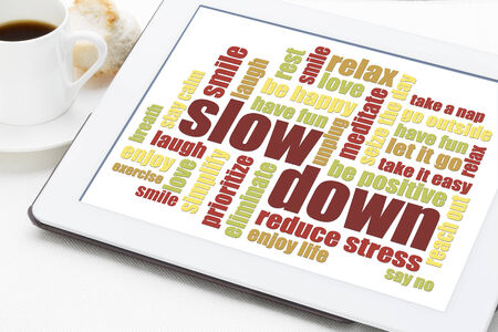 unplug: slow down and relax - reducing stress tips in a form of a word cloud on a digital tablet
