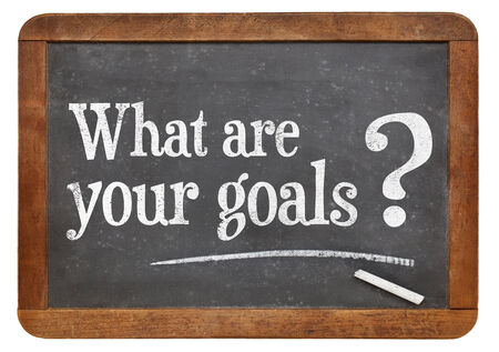 what are your goals  question  on a vintage blackboard isolated on white