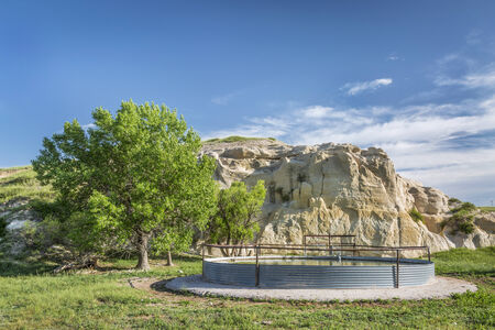pawnee grassland: cattle water tank and rock cliff,  Pawnee National Grassland in northern Colorado