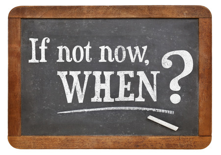 when: call for action or decision - if not now, when question  on  vintage slate blackboard, isolated on white Stock Photo