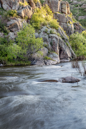 North Fork of Cache la Poudre River with springtime flow in Eagle Nest Open Space in northern Colorado at Livermore near Fort Collins, Colorado