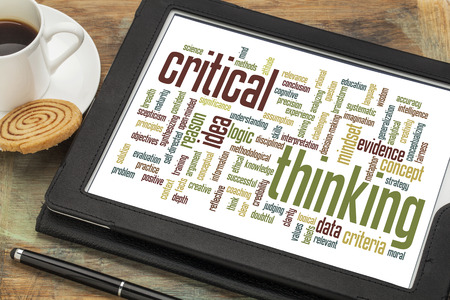 critical thinking: critical thinking word cloud on a digital tablet with a cup of coffee