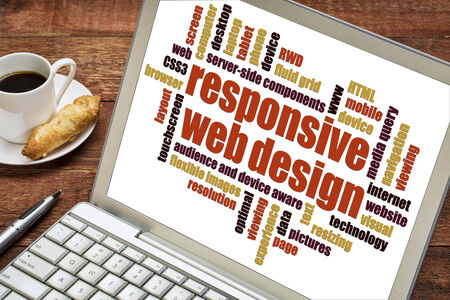 website words: responsive web design word cloud on a laptop screen with a cup of coffee Stock Photo