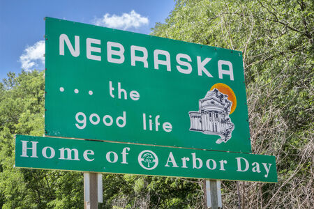 good life: Nebraska , the good life, home of Arbor Day - roadside welcome sign at state border Editorial