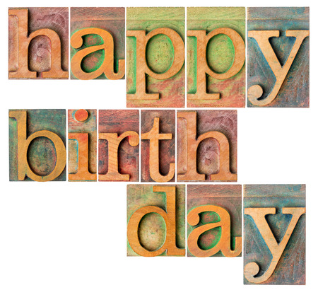 happy birthday - a collage of isolated letterpress wood type printing blocks photo
