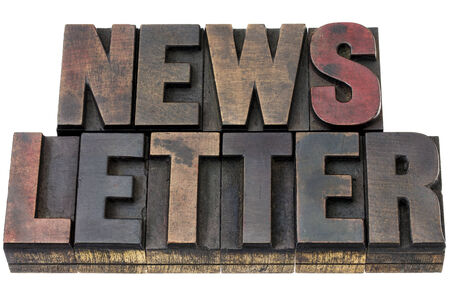 newsletter - isolated word in vintage letterpress wood type with ink patina Stok Fotoğraf