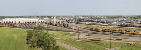 east meets west: NORTH PLATTE, NEBRASKA, JULY 14, 2014: Panoramic view of Union Pacifics Bailey rail yard from Golden Spike Tower. It is where east meets west on the Union Pacific line. The worlds largest train yard is handling 10,000 cars each day. Editorial
