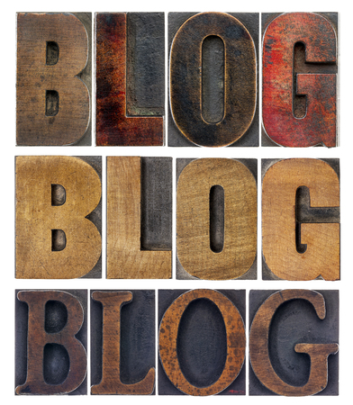 letterpress letters: blog word in isolated antique wood letterpress printing blocks, stained by color inks, a collage of words in a variety of fonts Stock Photo