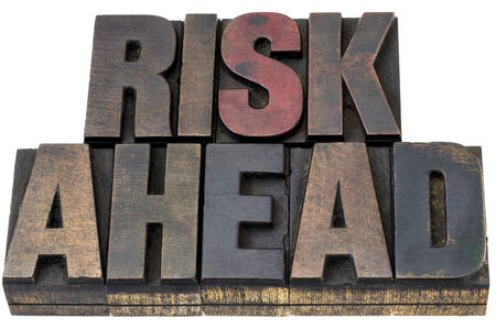 printing block: risk ahead - isolated words in vintage letterpress wood type with ink patina Stock Photo