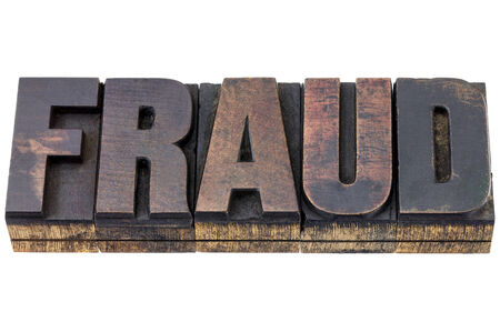 patina: fraud word - isolated text in vintage letterpress wood type with ink patina Stock Photo