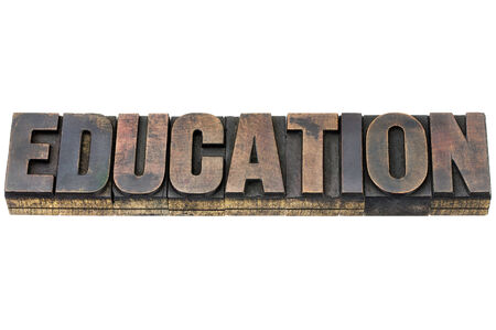 patina: education word - isolated text in vintage letterpress wood type with ink patina Stock Photo