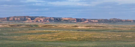 pawnee grassland: Pawnee National Grassland in northern Colorado  -  a panoramic view of short grass prairie and Chalk Bluff cliff in sunset light