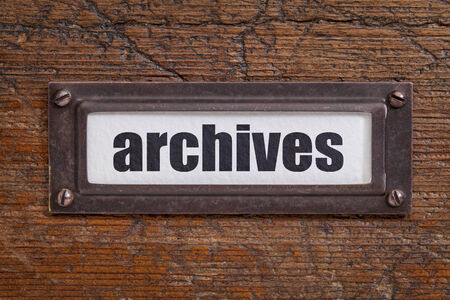 archives  tag - file cabinet label, bronze holder against grunge and scratched wood