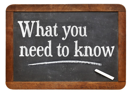 tutorial or advice concept - what you need to know - white chalk text  on a vintage slate blackboard Stockfoto